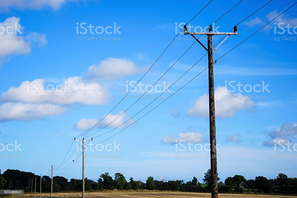 Electric lines at blue sky stock photo