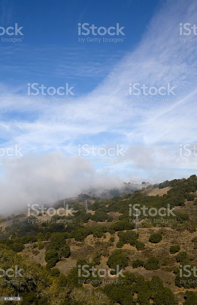 Electric lines on hillside royalty-free stock photo