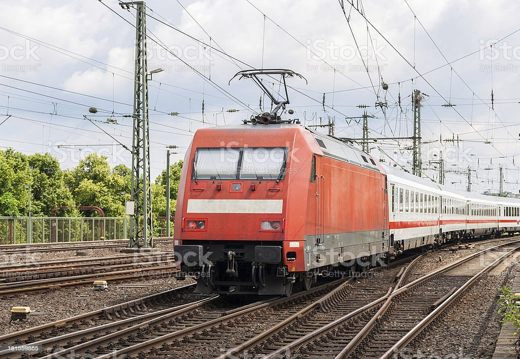 Electric locomotive with passenger train on Cologne station, Ger royalty-free stock photo