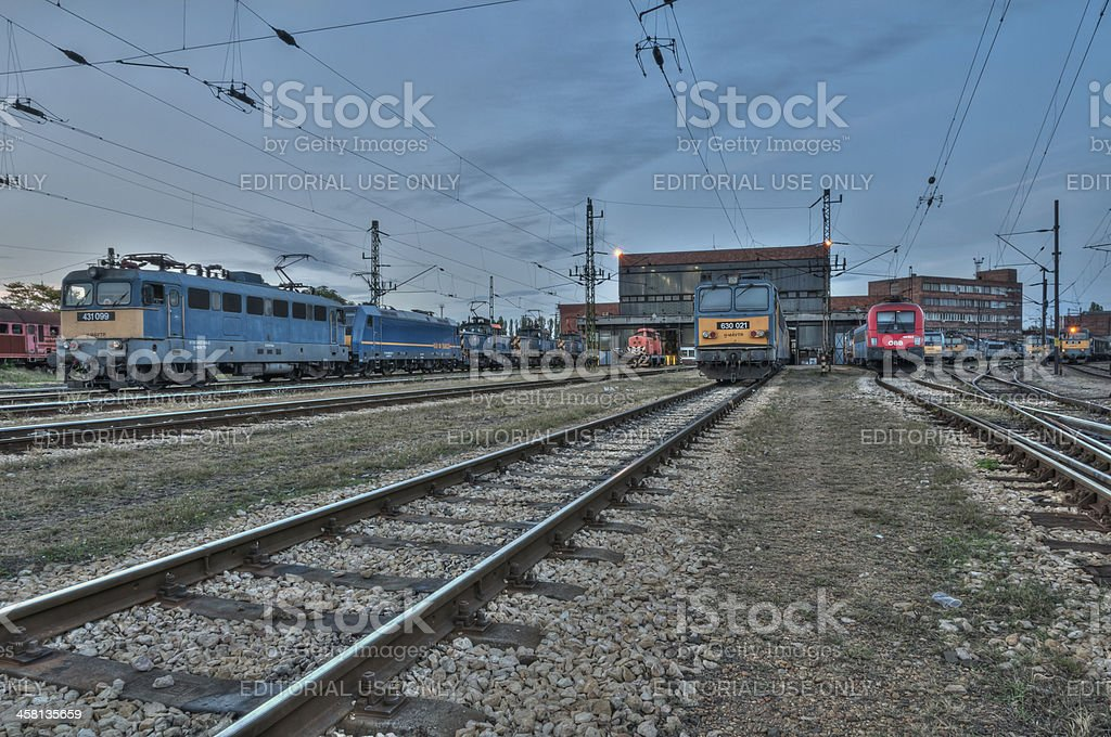 Electric locomotives on a railyard royalty-free stock photo