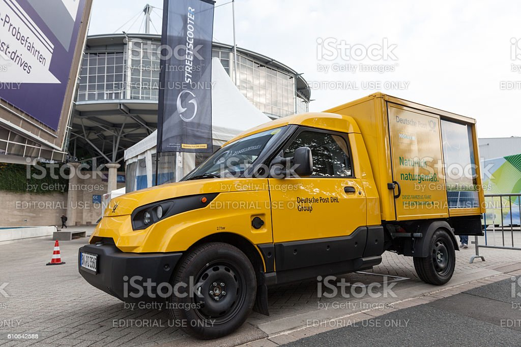 Electric mail delivery vehicle stock photo