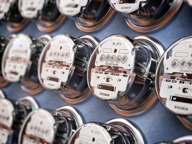 Electric meters in a row measuring power use. Electricity consumption concept. stock photo