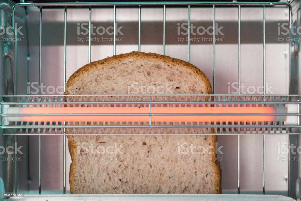 Electric micro oven with bread. stock photo