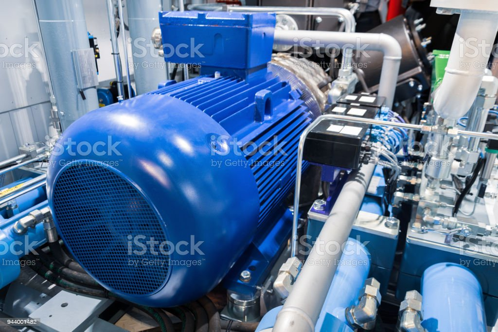 Electric motor of a powerful industrial gas compressor stock photo