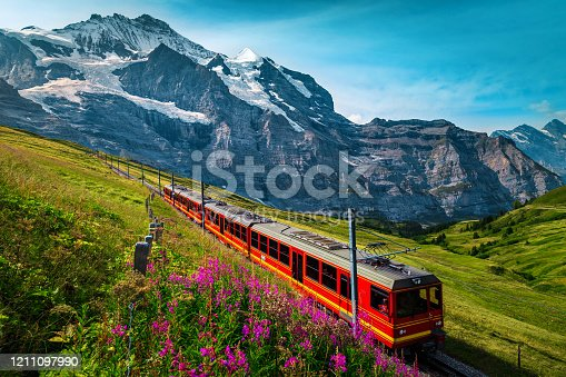 istock Electric passenger train and snowy Jungfrau mountains in background, Switzerland 1211097990