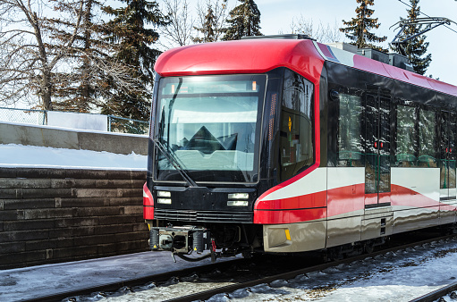Light Rail Train on Tracks covered in Snow on a Sunny Winter Day