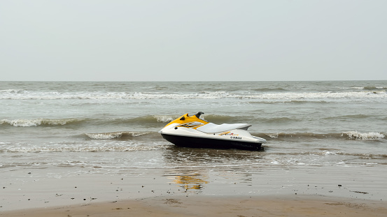 Electric personal watercraft vehicle for Jet skiing Water sports enthusiast in an empty sea beach. Jet skiing is sport racing over a body of water. A famous Asian Beach Games. Goa India