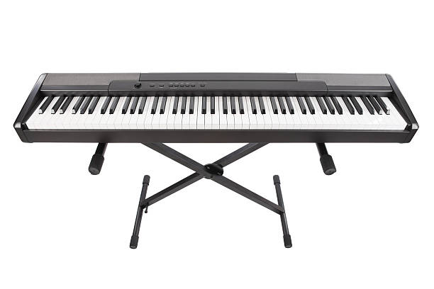 Electric Piano Isolated On White Electric Piano Isolated On White synthesizer stock pictures, royalty-free photos & images