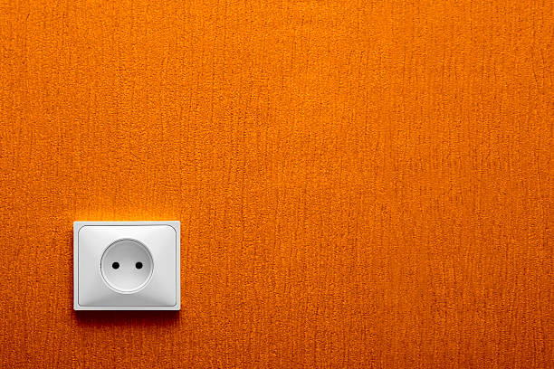 Electric Plug-in eine orange Wand – Foto