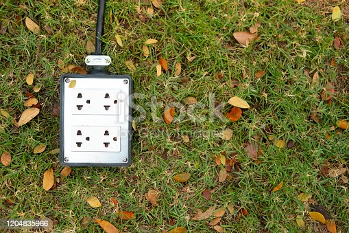 Electric plug socket in the field grass garden for party