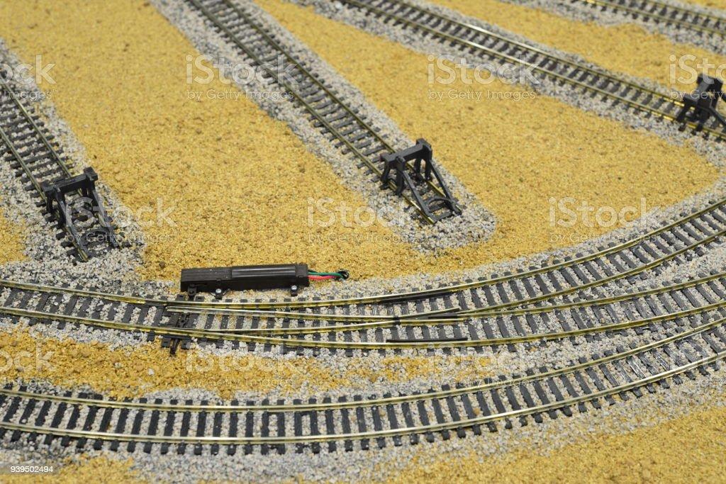 Electric points on a model railway desert landscape stock photo