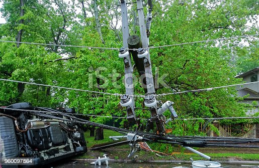 istock electric pole after hurricane damaged car turned over after accident 960097864