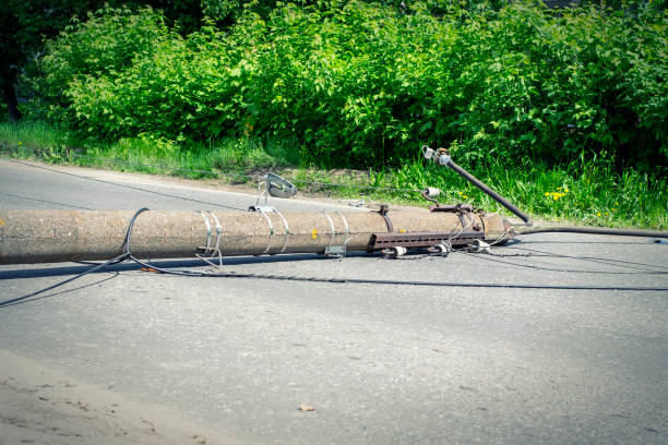 Electric pole. Broken broken wood power line post with electrical components on the ground after accident. Electric pole. Broken broken wood power line post with electrical components on the ground after accident. knocked down stock pictures, royalty-free photos & images
