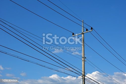 Electric Pole with blue autumn sky and clouds.