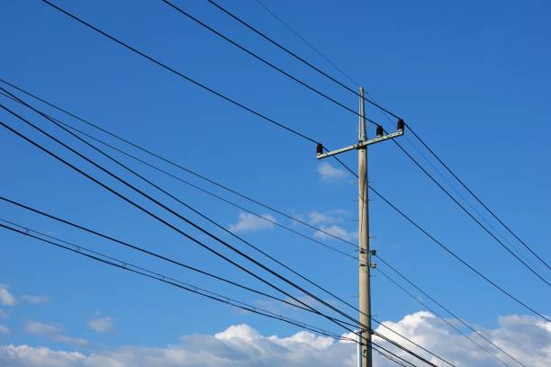 Electric pole Electric Pole with blue autumn sky and clouds. power line stock pictures, royalty-free photos & images