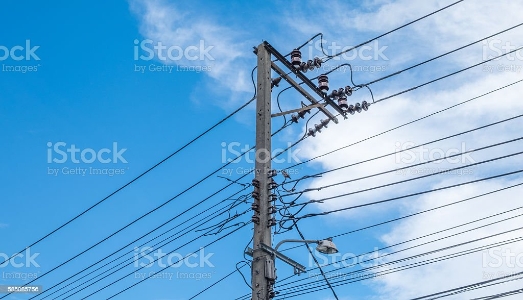 electric pole power lines and wires with blue sky. - Photo