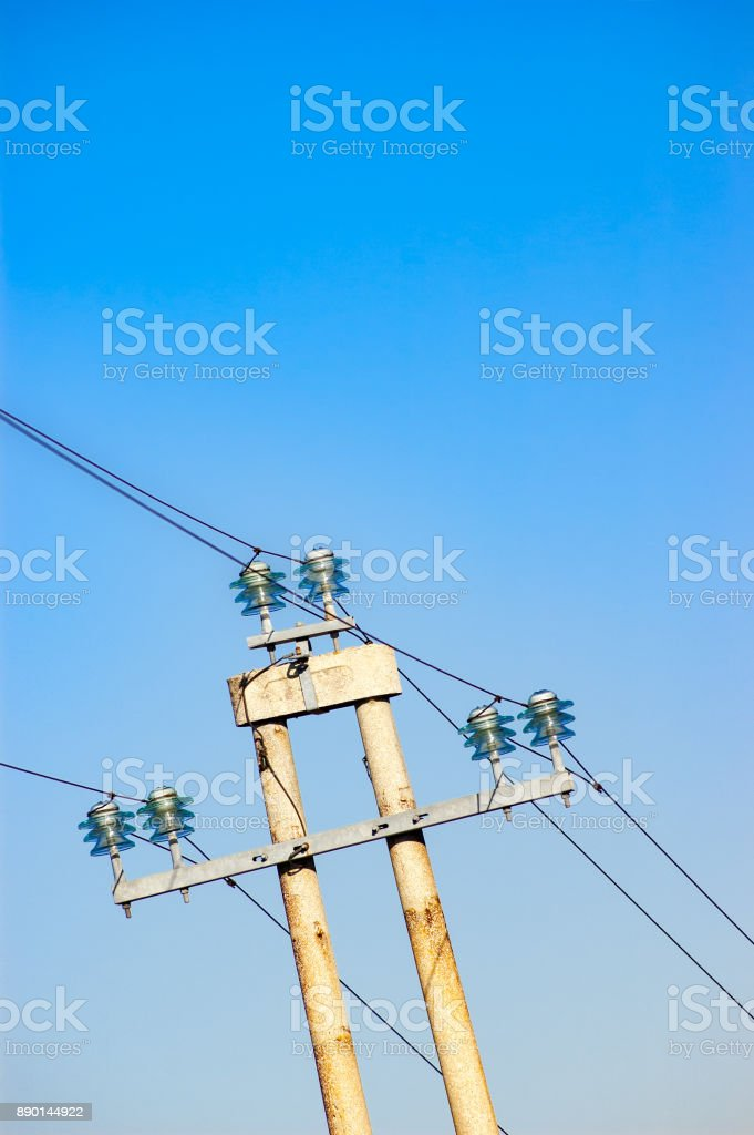 Electric power line gainst clear blue sky stock photo