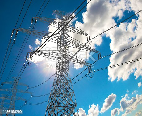 Electric Power Lines and Transmission Tower, Electric grid at Sunny Day