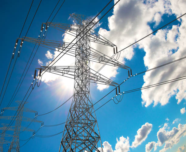 Electric Power Lines and Transmission Tower, Electric grid at Sunny Day stock photo