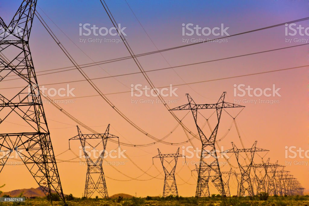 Electric Power Lines and Transmission Tower, Electric grid at sunset stock photo