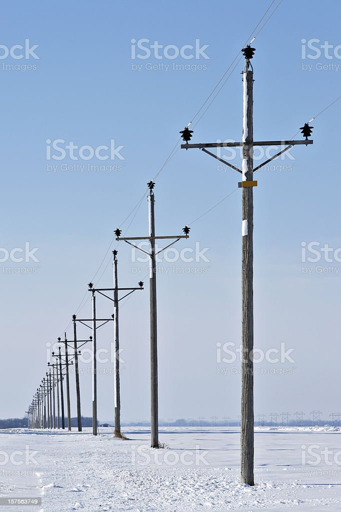 electric power lines in winter royalty-free stock photo