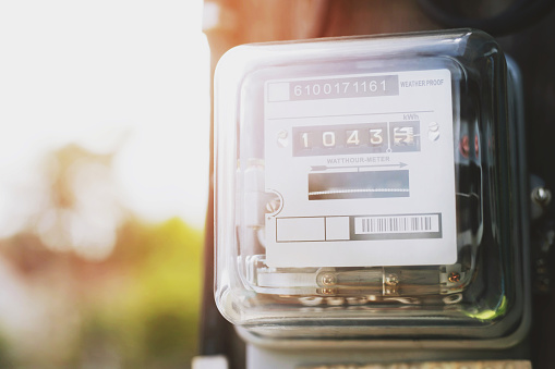 istock Electric power meter measuring power usage. Watt hour electric meter measurement tool at pole, outdoor electricity for use in home appliance monitor the home's electrical energy consumption. 1174822883