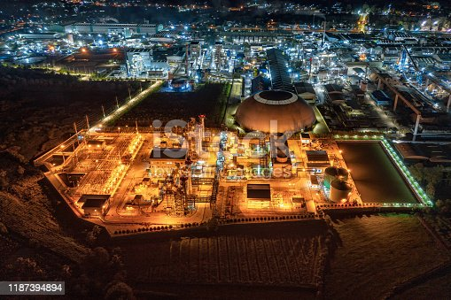 Aerial view Electric power plant substation illumination, Export-oriented manufacturing paper packaging and corrugated industry at night
