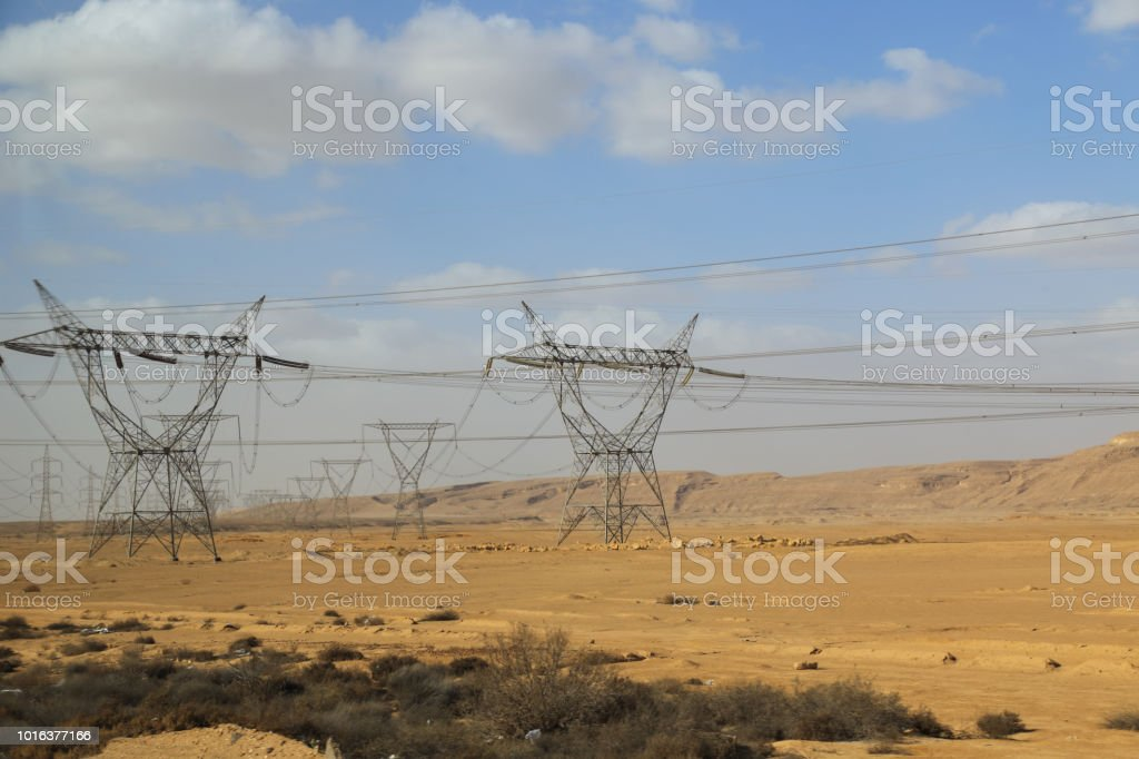Electric power tower in Sahara Desert stock photo