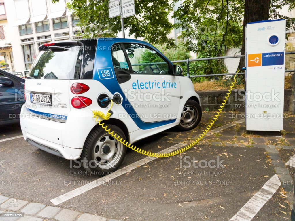 Electric powered Smart getting recharged stock photo