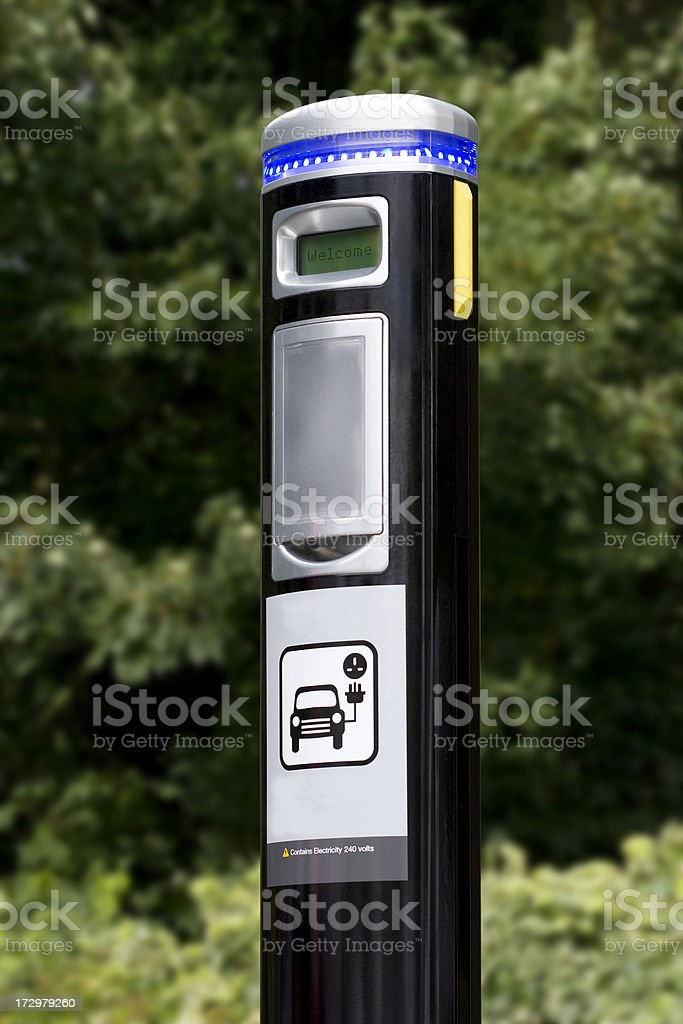 Electric powered vehicle street charging point royalty-free stock photo