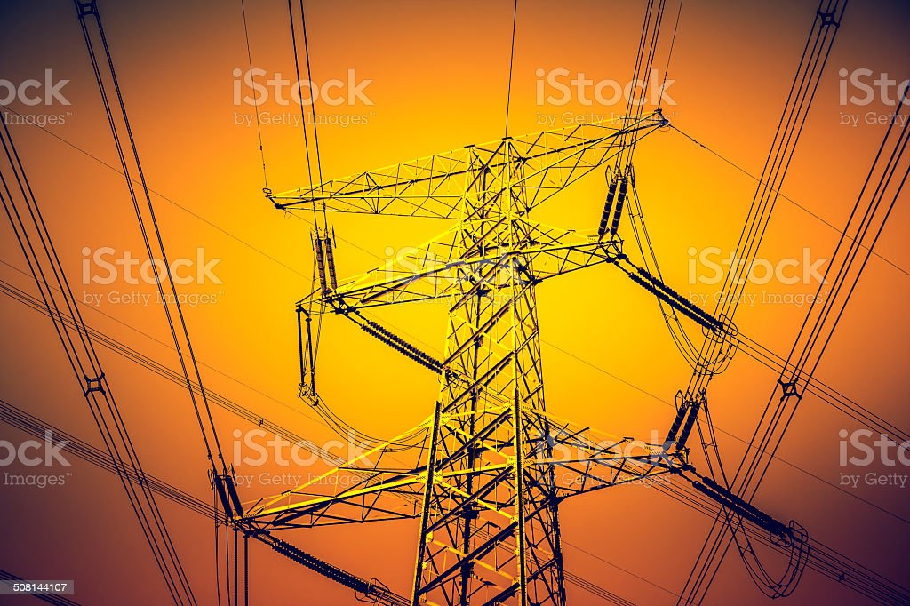 Electric pylon and power lines stock photo