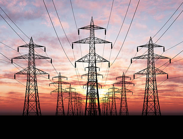 Electric Pylons Electric power lines over sunrise electricity pylon stock pictures, royalty-free photos & images