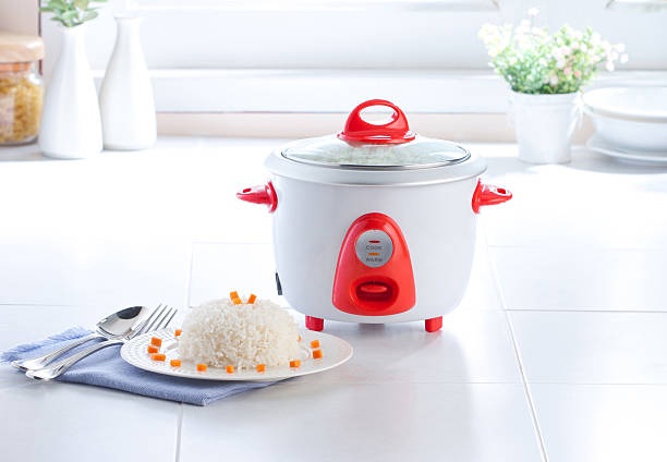 Electric rice cooking pot in the kitchen stock photo
