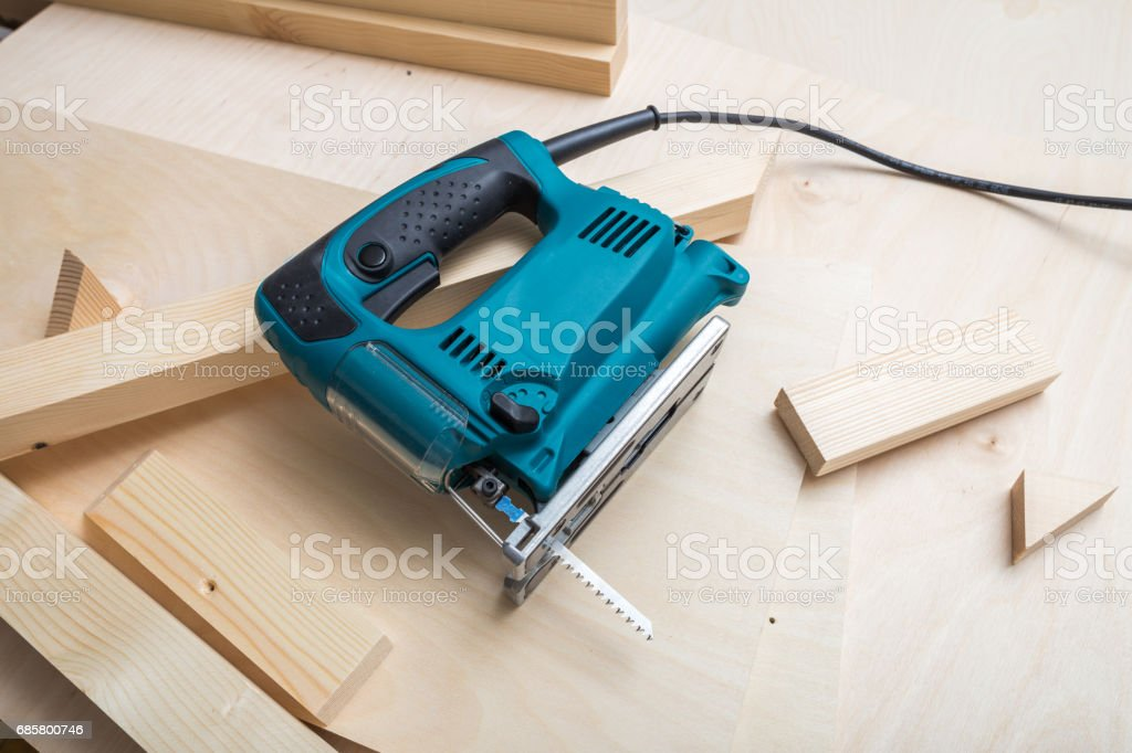 Electric Saw and Wooden Stacks stock photo