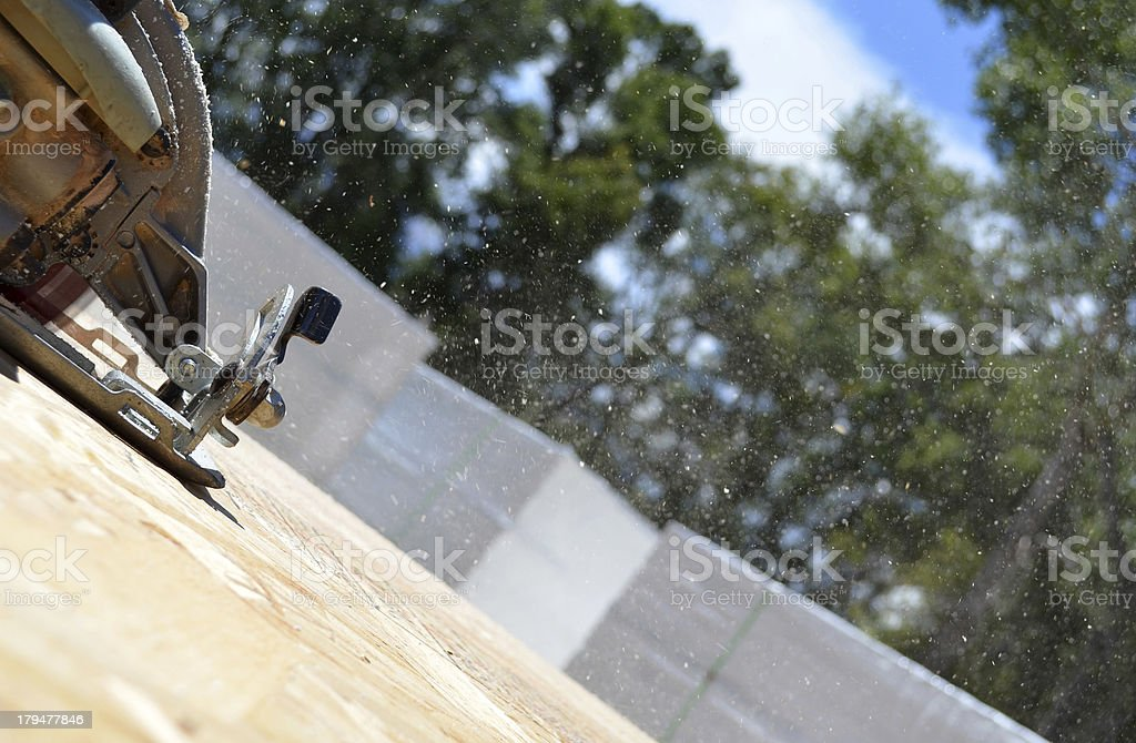 electric saw cutting wood royalty-free stock photo