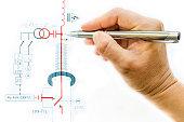 female hand draw and analyze an electric scheme