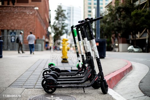Electric scooters in a city available for rent