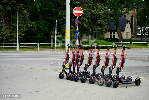 Jurmala, Latvia - August 14, 2019: Electric scooters of the company CityBee, parked on street of Jurmala. Self-service rental of a small transport using smartphone application