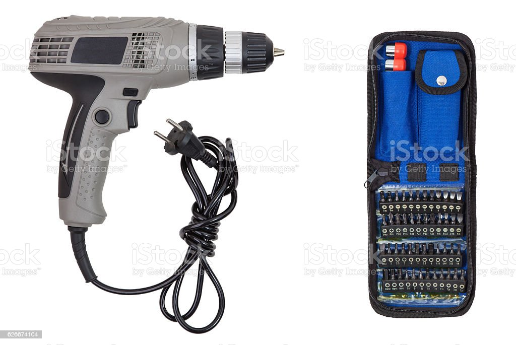 Electric screwdriver and set bits stock photo