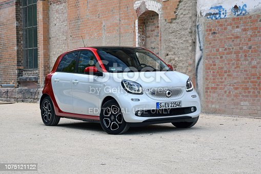 Stuttgart, Germany - 11 October, 2018: Zero emission Smart Forfour EQ on the street. This model is one of the smallest electric vehicles from Daimler.