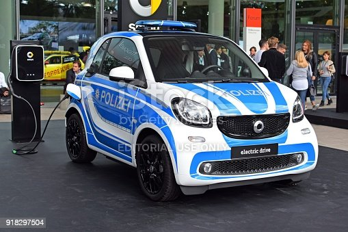 Frankfurt, Germany - 12 September, 2017: Electric Smart Fortwo police car on the exhibition point during the IAA Motor Show 2017. This vehicle is one of the smallest mass-produced electric cars in Europe.