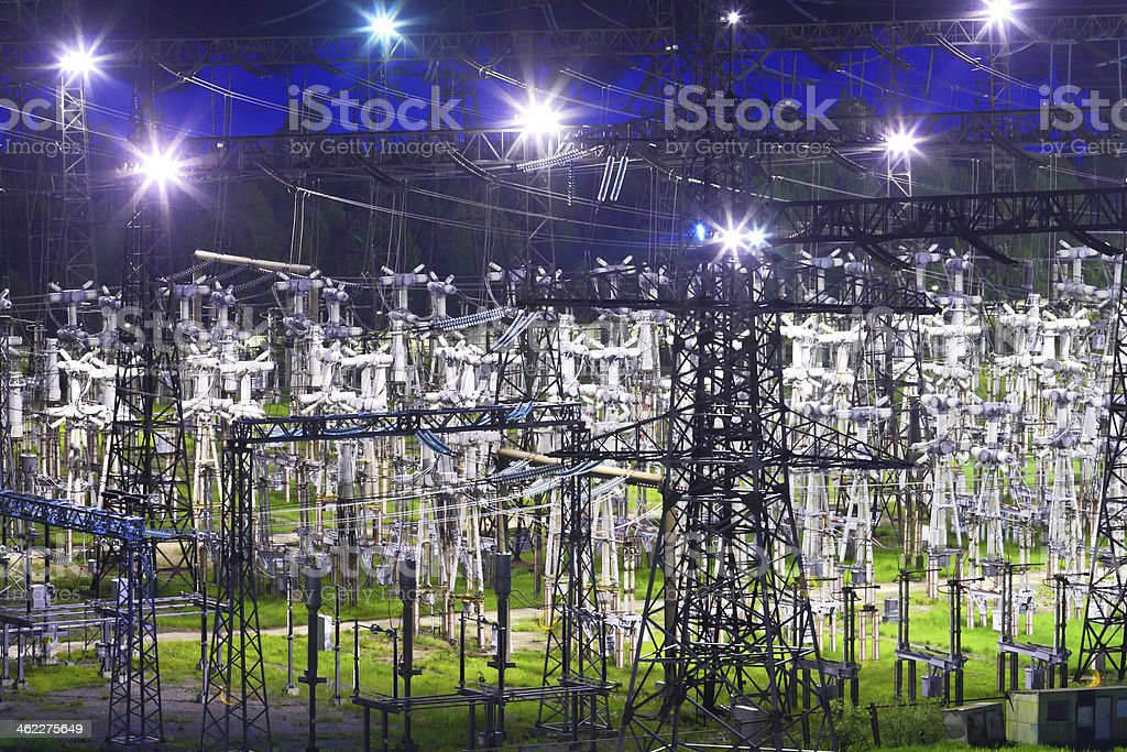 Electric substation in night-time lighting stock photo