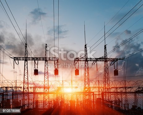 istock Electric substation on a background of the coming sun. 910578586
