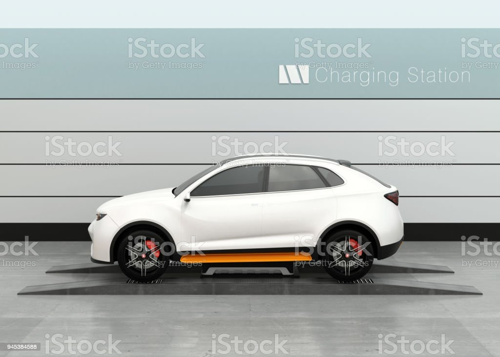 Electric SUV car exchange battery in battery swapping station stock photo