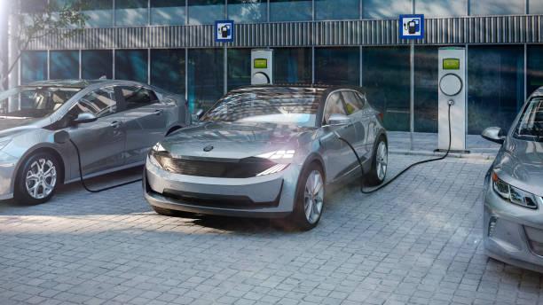 electric suv of the future charging electricity with public charger - macchina ibrida foto e immagini stock