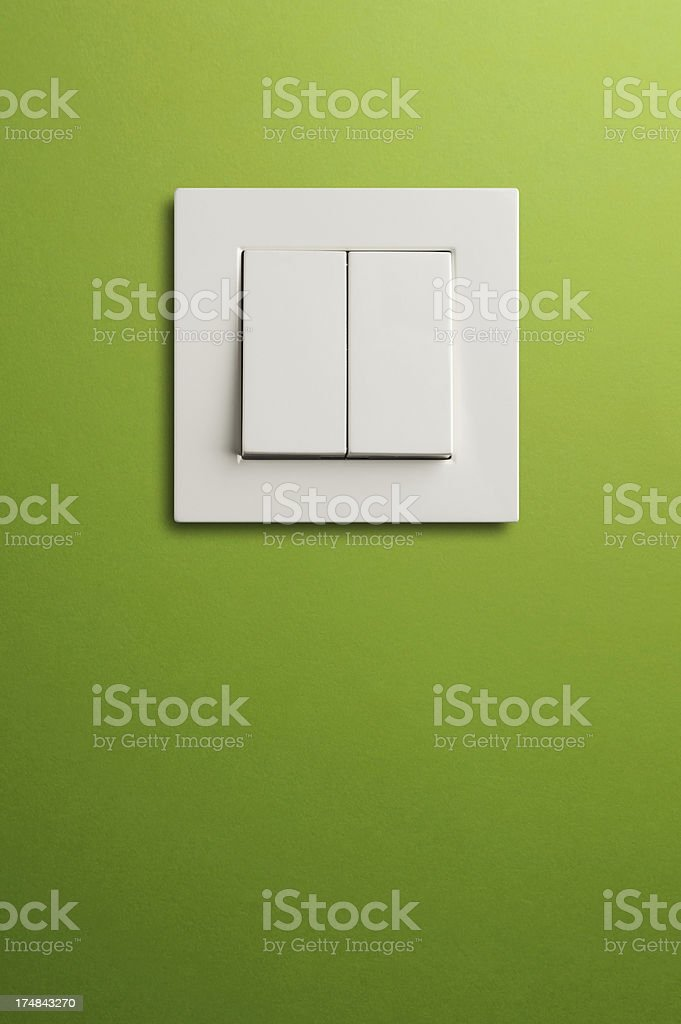 Electric switch in on green wall royalty-free stock photo