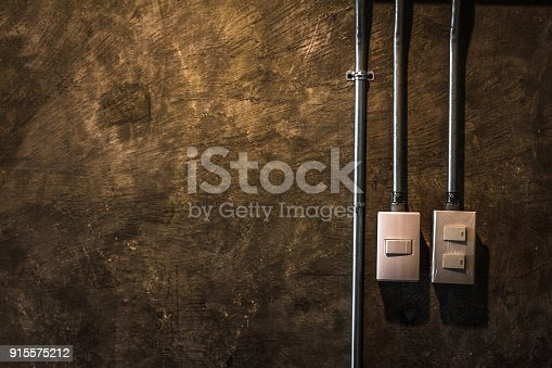 940992564 istock photo electric switch with brown rock surface background. 915575212