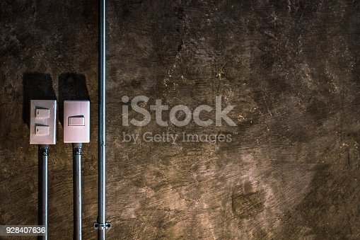 940992564 istock photo electric switch with brown rock surface background. 928407636