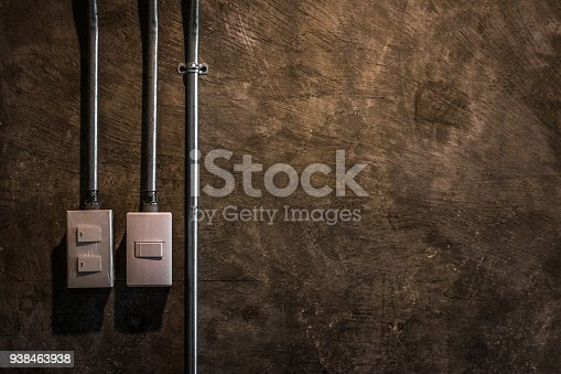 940992564 istock photo electric switch with brown rock surface background. 938463938