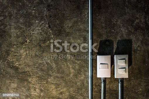 940992564 istock photo electric switch with brown rock surface background. 939856210